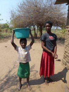 Luwa Carrying Water